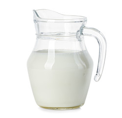 Glass jug of fresh milk isolated on white background