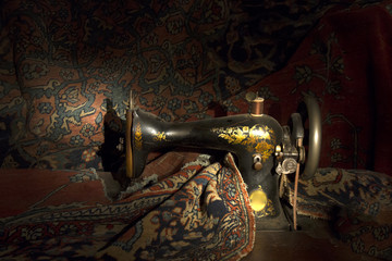 Antique sewing machine with tapestry