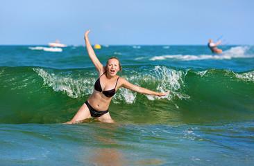 Woman bathing in sea