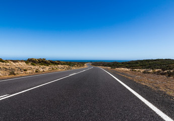 The straight and bend road on the great ocean road in Australia