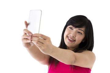 Asian Woman taking 'selfie' portrait photograph.