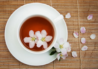 Wall Mural - Cup of tea and spring blossom