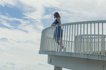 Woman on foot bridge in summer