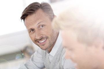 Portrait of middle-aged man working in office