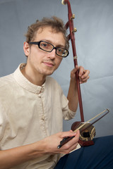 Young musician playing in erhu.