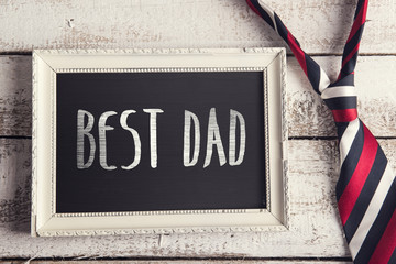 Fathers day composition. Studio shot on white wooden background
