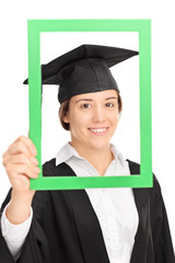 Female student posing behind a green picture frame