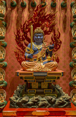 small statue of Buddha, in a Buddhist temple in Singapore