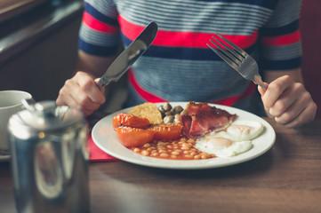 Woman having breakfast in diner