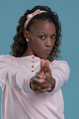 Woman making pistol gesture