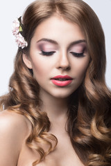 girl with flowers in her hair and pink makeup.