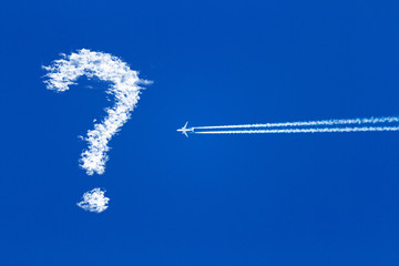 jet airplane on blue sky, question mark in the sky