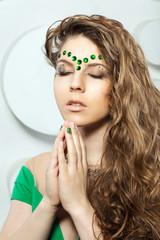 fashion girl, with stones, praying, green stones