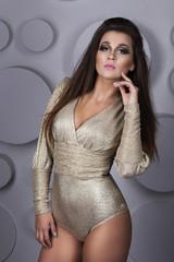 beautiful girl in a gold dress
