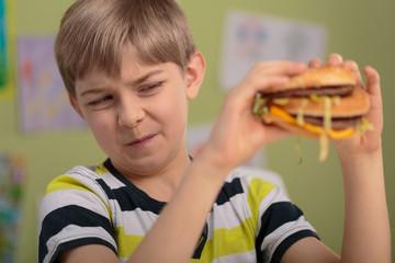Boy don't like hamburger