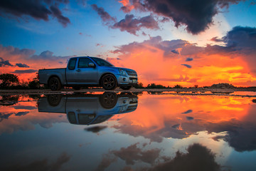 Car and sunset sky