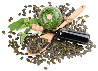 Wall Mural - Pumpkin seed oil, raw pumkin and seeds, view from above