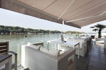 Modern riverside cafe terrace