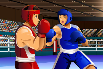 Boxers fighting in ring