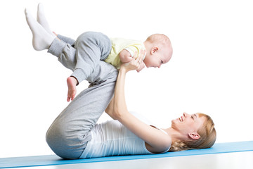 young woman have fun with her son doing yoga exercises