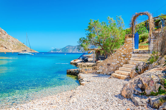 Stairs from sandy beach on Greece island Kalymnos