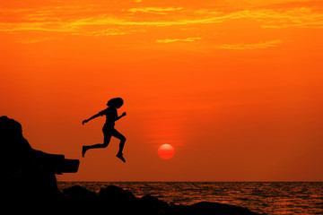 silhouette jumping relax at sunset