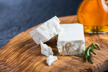 Feta cheese on wooden board