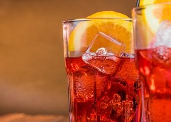Fototapete - spritz aperitif aperol cocktail with two orange slices
