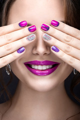 girl with a bright make-up and manicure with rhinestones.