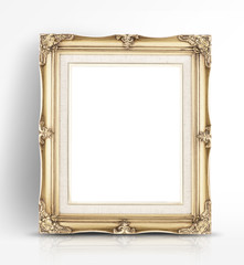 Blank golden vintage photo frame lean at wall in glossy white st