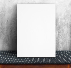 Black White paper poster lean at concrete wall and fabric table,