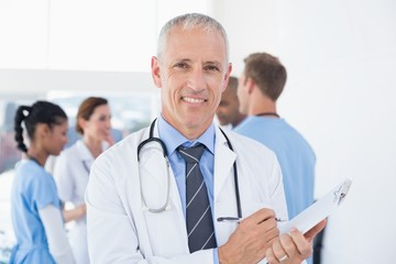 Confident male doctor smiling at camera