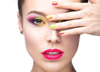 Beautiful girl with bright colored makeup and nail polish