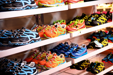 Shelves with sport shoes, sport store