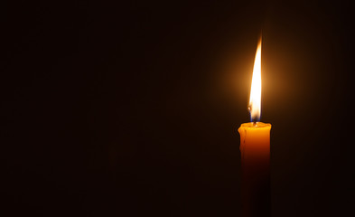 Candle light in darkness  as light for life