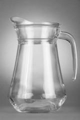 Empty jug on gray