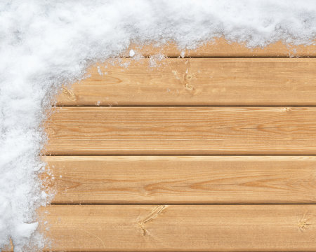 Snow-covered wooden surface