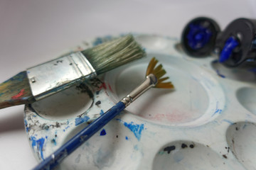 Paintbrushes on plastic palette