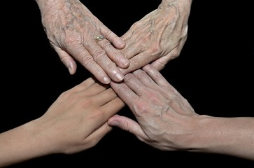 family generations of four hands on black