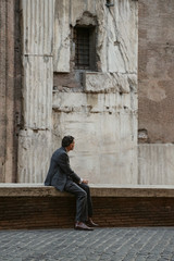 Lone businessman in the ancient city