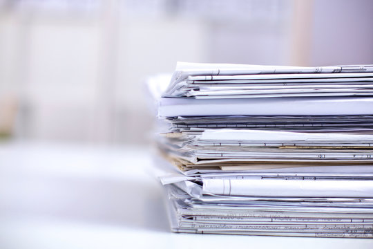 Big stack of papers ,documents on the desk
