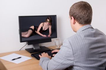 xxx concept - man looking adult content on computer in office