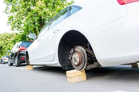 Car with stolen wheels