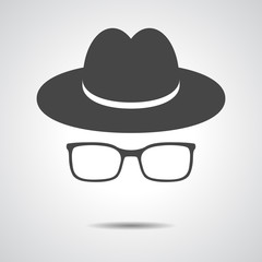 black hat with glasses on a grey background