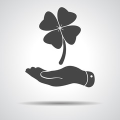 flat hand showing clover with four leaves sign icon