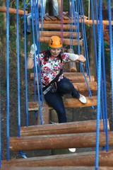 Woman climber sitting on a log