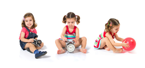 Kid holding a clock over white background