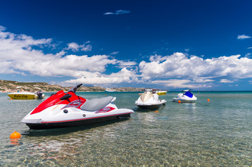 Poster Water Motor sporten Colorful Jetski on the beach of holiday season