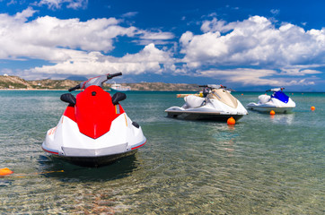 Poster Water Motor sporten Jet skis anchored near the beach