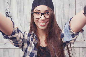 Hipster girl in glasses and black beanie